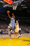 Denver Nuggets v Golden State Warriors: Ty Lawson and Dan Gadzuric Photographic Print by Rocky Widner