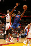 Detroit Pistons v Miami Heat: Rodney Stuckey and Chris Bosh Photographic Print by Issac Baldizon