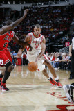 Chicago Bulls v Houston Rockets: Shane Battier and Luol Deng Photographic Print by Bill Baptist
