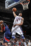 Atlanta Hawks v New Jersey Nets: Derrick Favors Photographic Print by Jesse D. Garrabrant