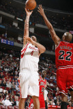 Chicago Bulls v Houston Rockets: Luis Scola and Taj Gibson Photographic Print by Bill Baptist