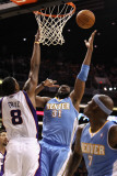 Denver Nuggets v Phoenix Suns: Nene Photographic Print by Christian Petersen