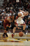 Miami Heat v Cleveland Cavaliers: Mo Williams and Carlos Arroyo Photographic Print by David Liam Kyle