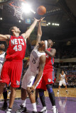 New Jersey Nets v Sacramento Kings: DeMarcus Cousins and Kris Humphries Photographic Print by Don Smith