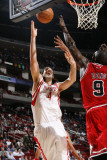 Chicago Bulls v Houston Rockets: Luis Scola and Luol Deng Photographic Print by Bill Baptist