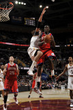 Philadelphia 76ers v Cleveland Cavaliers: Jrue Holiday and Anderson Varejao Photographic Print by David Liam Kyle