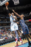 Charlotte Bobcats v New Orleans Hornets: David West and Boris Diaw Photographic Print by Layne Murdoch