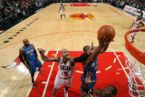 Orlando Magic v Chicago Bulls: Carlos Boozer, Rashard Lewis and Dwight Howard Photographic Print by Gary Dineen