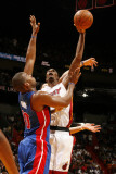 Detroit Pistons v Miami Heat: Chris Bosh and Greg Monroe Photographic Print by Issac Baldizon