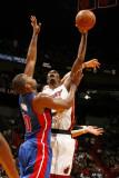 Detroit Pistons v Miami Heat: Chris Bosh and Greg Monroe Photographic Print by Issac Baldizon