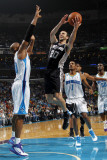 San Antonio Spurs v New Orleans Hornets: Manu Ginobili and David West Photographic Print by Layne Murdoch