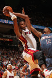 Charlotte Bobcats v Miami Heat: Chris Bosh and Tyrus Thomas Photographic Print by Victor Baldizon
