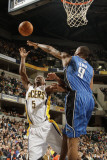 Orlando Magic v Indiana Pacers: T. J. Ford and Rashard Lewis Photographic Print by Ron Hoskins