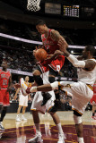 Chicago Bulls v Cleveland Cavaliers: Derrick Rose and Mo Williams Photographic Print by David Liam Kyle