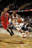 Chicago Bulls v Cleveland Cavaliers: Mo Williams and Derrick Rose Photographic Print by David Liam Kyle