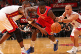 Philadelphia 76ers v Miami Heat: Jrue Holiday, Chris Bosh and Carlos Arroyo Photographic Print by Victor Baldizon