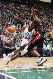 Miami Heat v Utah Jazz: Paul Millsap and Mario Chalmers Photographic Print by Melissa Majchrzak