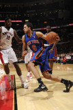 New York Knicks v Toronto Raptors: Landry Fields and Amir Johnson Photographic Print by Ron Turenne