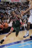 Milwaukee Bucks v Dallas Mavericks: Brandon Jennings and Tyson Chandler Photographic Print by Glenn James