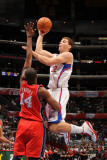 New Jersey Nets v Los Angeles Clippers: Blake Griffin and Derrick Favors Photographic Print by Noah Graham