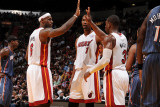 Charlotte Bobcats v Miami Heat: LeBron James, Chris Bosh and Dwyane Wade Photographic Print by Andrew Bernstein