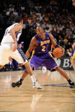 Los Angeles Lakers v New Jersey Nets: Kobe Bryant and Devin Harris Photographic Print by Andrew Bernstein