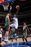 Milwaukee Bucks v Philadelphia 76ers: Jrue Holiday and Andrew Bogut Photographic Print by Jesse D. Garrabrant