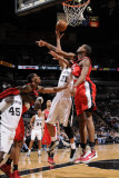 Portland Trail Blazers v San Antonio Spurs: Tim Duncan and Marcus Camby Photographic Print by D. Clarke Evans