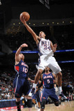 Atlanta Hawks v New Jersey Nets: Devin Harris and Mike Bibby Photographic Print by Jesse D. Garrabrant