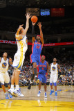 Detroit Pistons v Golden State Warriors: Andris Biedrins and Richard Hamilton Photographic Print by Rocky Widner