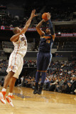 Denver Nuggets v Charlotte Bobcats: Carmelo Anthony and Boris Diaw Photographic Print by Kent Smith