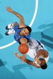 Dallas Mavericks v New Orleans Hornets: Tyson Chandler and Trevor Ariza Photographic Print by Chris Graythen