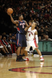 Atlanta Hawks v Toronto Raptors: Joe Johnson and Jerryd Bayless Photographic Print by Ron Turenne