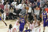 Los Angeles Lakers v Houston Rockets: Kobe Bryant and Shane Battier Photographic Print by Bill Baptist