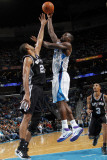 San Antonio Spurs v New Orleans Hornets: Emeka Okafor and Tim Duncan Photographic Print by Layne Murdoch