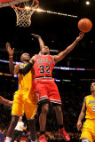 Chicago Bulls v Los Angeles Lakers: C.J. Watson and Lamar Odom Photographic Print by Noah Graham