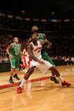 Boston Celtics v Toronto Raptors: Amir Johnson and Kevin Garnett Photographic Print by Ron Turenne