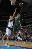 Milwaukee Bucks v Dallas Mavericks: Brandon Jennings and Dirk Nowitzki Photographic Print by Danny Bollinger