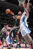 Milwaukee Bucks v Denver Nuggets: Corey Maggette and Chris Andersen Photographic Print by Garrett Ellwood