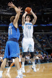 Dallas Mavericks v New Orleans Hornets: Jason Smith and Dirk Nowitzki Photographic Print by Layne Murdoch