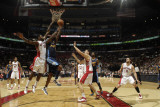 Denver Nuggets v Toronto Raptors: Al Harrington and Amir Johnson Photographic Print by Ron Turenne