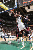 Miami Heat v Utah Jazz: Al Jefferson and Dwayne Wade Photographic Print by Melissa Majchrzak
