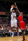 Chicago Bulls v Sacramento Kings: Jason Thompson and Luol Deng Photographic Print by Rocky Widner