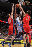 New Jersey Nets v Denver Nuggets: Nene, Kris Humpries and Brook Lopez Photographic Print by Garrett Ellwood