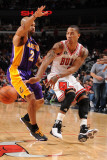 Los Angeles Lakers v Chicago Bulls: Derrick Rose and Derek Fisher Photographic Print by Andrew Bernstein