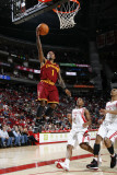 Cleveland Cavaliers v Houston Rockets: Daniel Gibson and Kyle Lowry Photographic Print by Bill Baptist