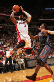 Charlotte Bobcats v Miami Heat: Dwyane Wade and Gerald Wallace Photographic Print by Victor Baldizon