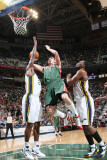 Milwaukee Bucks v Utah Jazz: Ersan Ilyasova, Al Jefferson and C.J. Miles Photographic Print by Melissa Majchrzak