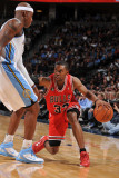 Chicago Bulls v Denver Nuggets: C.J. Watson and Al Harrington Photographic Print by Garrett Ellwood