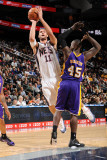Los Angeles Lakers v New Jersey Nets: Brook Lopez and Derrick Caracter Photographic Print by Andrew Bernstein